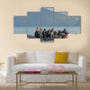 Refugee migrants, arrived on Lesvos in inflatable dinghy boats Multi Panel Canvas Wall Art