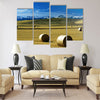 Hay bales on a field, with snow-covered mountains Multi panel canvas wall art