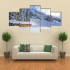 Chad with firewood in Austrian Alps during winter time Multi panel canvas wall art