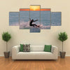 Young man on Aruba island in the Caribbean Sea Multi panel canvas wall art