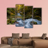 Magically colorful autumn in a wild old forest park with a pure stream cascading down the mountain Multi panel canvas wall art
