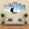 Successful silhouette man winner waving Suriname flag on top of the mountain peak Multi Panel Canvas Wall Art