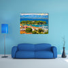 A Waterfront View With Mountains And Greenery Around Multi Panel Canvas Wall Art
