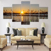 Spring sunset on the river, the sun in the reeds Multi panel canvas wall art