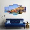 Old town and port of Jaffa and modern skyline of Tel Aviv city, Israel Multi Panel Canvas Wall Art