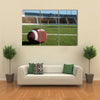 American football on field with goal post in background Multi panel canvas wall art
