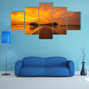 A Beautiful sunset at Maldivian beach Multi Panel Canvas Wall Art