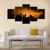 Military silhouettes fighting scene on war fog sky background Multi Panel Canvas Wall Art