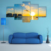 A Couple Enjoys An Idyllic Sunset Stroll Along The Silhouetted Boardwalk Multi Panel Canvas Wall Art