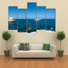 IA beautiful white fishing boat in the ocean is engaged in trolling Multi panel canvas wall art