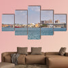 The military area with yellow buildings in Cartagena, Spain multi panel canvas wall art