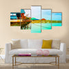 Old boat on the green sea with blue sky Multi Panel Canvas Wall Art