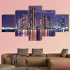 Tokyo skyline by night in modern Tsukishima district multi panel canvas wall art