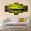 Intense northern lights (Aurora borealis) over Lake Laberge, Yukon Territory, Canada, with fall colored willows on lake shore Multi panel canvas wall art