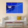 Image of a ping-pong ball with a racket on a table.multi panel canvas wall art