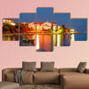 Nighttime view of Simuni village on Pag Island, Croatia multi panel canvas wall art