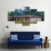 Almost destroyed houses in jungle of Cameroon where people live Multi panel canvas wall art