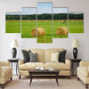 Green meadow with hay rolls Multi panel canvas wall art
