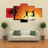 man and girl holding hands and jumping on hill near bare tree, orange background multi panel canvas wall art