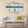 One seagull bird standing resting on an orange buoy on a lake. Calm beautiful seascape view wall art