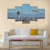 American Airline take off from the busy Los Angeles International Airport multi panel canvas wall art