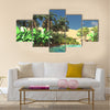Luxurious tropical vegetation on wasteland later in the day Multi Panel canvas wall art