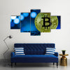 Golden bitcoin on keyboard against digital blue background multi panel canvas wall art