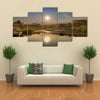 View of African lake with boat and mountains Lubango Angola Multi panel canvas wall art