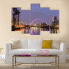 Night lights and the Clyde Arc Bridge at Glasgow City in Scotland over river. Multi Panel Canvas Wall Art