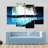 Computer generated landscape of an impossibly large moon backlighting the scene Multi Panel Canvas Wall Art