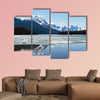 Snow covered rocky mountains peaks reflected canvas wall art
