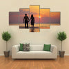 The image of two people in love at sunset multi panel canvas wall art