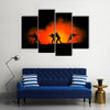 Military silhouettes of soldiers against the backdrop Multi panel canvas wall art