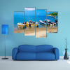 Unidentified tourists sailing in a boat on a Caribean beach in Taganga Colombia Multi Panel Canvas Wall Art