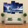 Astronaut Landing On Space Pulling Planet On Rope Multi Panel Canvas Wall Art Print Set