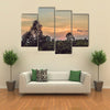 Red sunset over the rain forest Multi Panel Canvas Wall Art