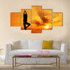 Silhouette of a beautiful Yoga woman in the morning Multi panel canvas wall art