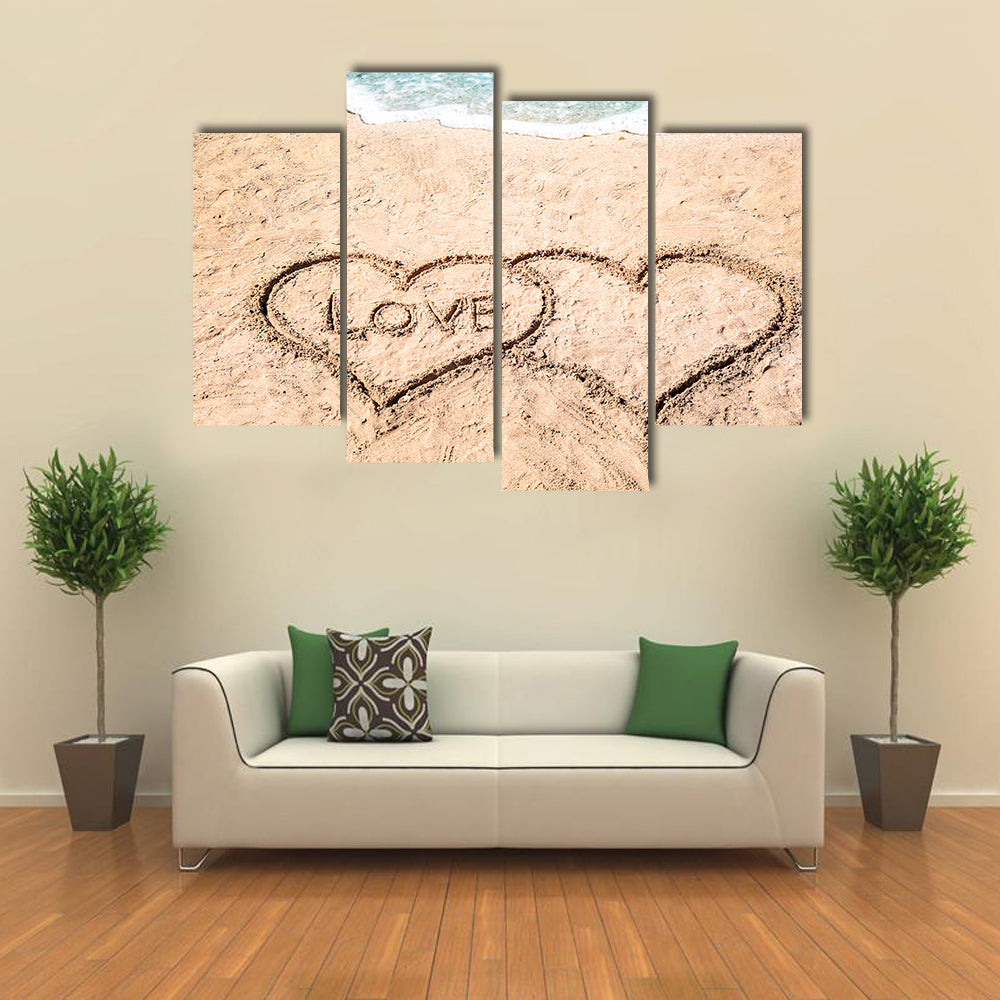 Word LOVE and hearts drawn on sand near water multi panel canvas wall art
