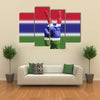 Gambia national flag painted onto a male hand Multi Panel Canvas Wall Art