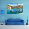 A Church In The Background And A Fishing Boat In Front Multi Panel Canvas Wall Art