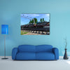 A Cargo Train That Is Carrying Many Tanks Multi Panel Canvas Wall Art