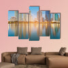 Blue twilight office building with water reflection multi panel canvas wall art