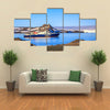 Blue antarctic cruise ship in the lagoon and penguins colony on the island Multi panel canvas wall art