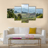 Green farmland fields landscape in Virunga volcano national park, Rwanda Multi panel canvas wall art