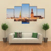 Riga Cathedrals, St. Peters Church Over The Bank Of River Riga, Latvia Multi Panel Canvas Wall Art