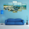 Airplanes on the runway of Cancun International Airport in Mexico Multi Panel Canvas Wall Art