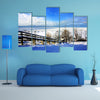 A beautiful winter scene at a lake multi panel canvas wall art