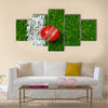 A Cricket ball on a grass next to the white line Multi Multi Panel Canvas Wall art