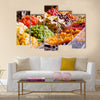 Colorful healthy dried fruits in the market, focus on figs, Multi panel canvas wall art