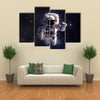 Astronaut Wandering In Outer Space Multi Panel Canvas Wall Art